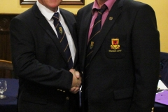 Incoming Captain, William Lacey being congratulated by Captain John McAndrew.