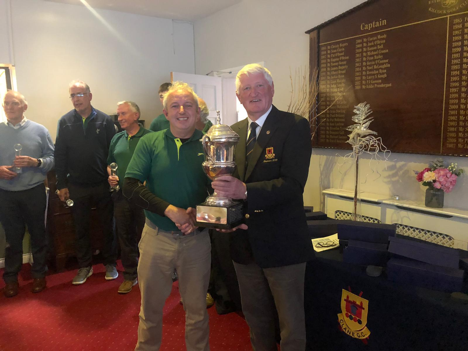 Capt. Maurice Byrne presenting CASC Cup to Captain of winning team, Sallins G.S., Hugh McCreevy